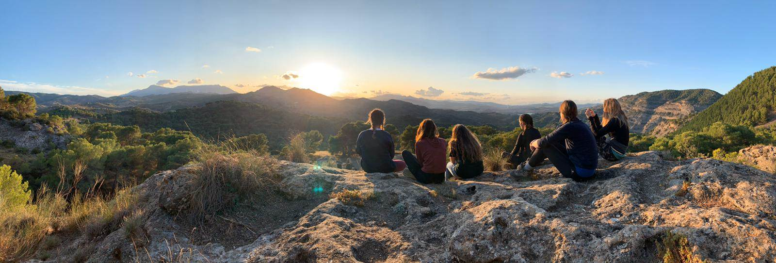 Watch the sunset over the Andalusian mountains after a day of hiking