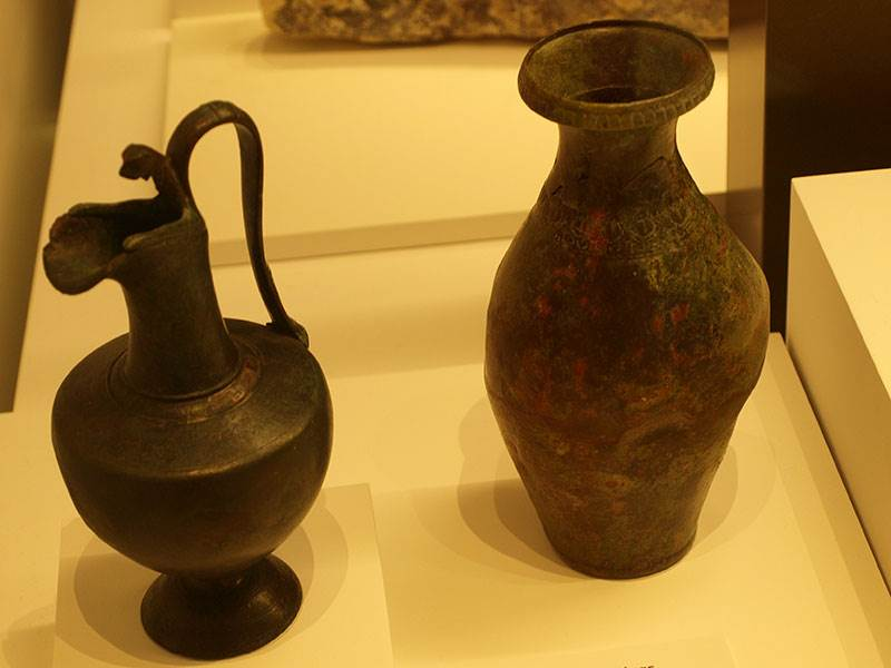 A pair of 1st century BC bronze Italic jugs (Malaga Archaeological Museum)